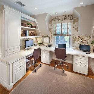 Design ideas for a traditional home office in DC Metro with a built-in desk.