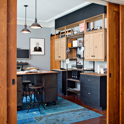 Example of a mid-sized urban freestanding desk medium tone wood floor home studio design in San Francisco with no fireplace and gray walls