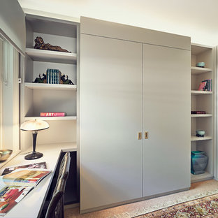 Design ideas for a traditional home office and library in London.
