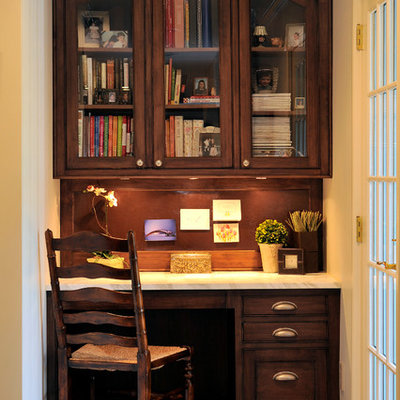 Example of a small classic built-in desk study room design in New York