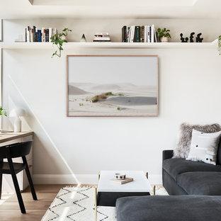 Imagen de despacho escandinavo, sin chimenea, con paredes blancas y suelo de madera clara