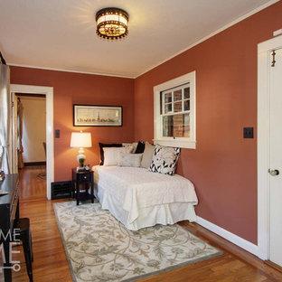 Mid-sized cottage freestanding desk light wood floor study room photo in Sacramento with orange walls