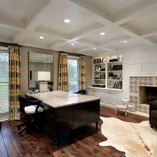 Cette image montre un bureau traditionnel avec un sol en bois foncé, une cheminée standard, un manteau de cheminée en carrelage et un bureau indépendant.