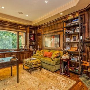 デンバーの中くらいのトラディショナルスタイルのおしゃれな書斎 (茶色い壁、濃色無垢フローリング、標準型暖炉、石材の暖炉まわり、自立型机、茶色い床) の写真