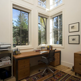 Inspiration for a mid-sized country freestanding desk light wood floor study room remodel in Denver with white walls