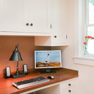 Study room - small traditional built-in desk study room idea in New York with white walls