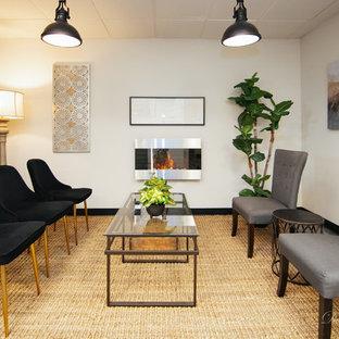 Inspiration för mellanstora klassiska arbetsrum, med vita väggar, linoleumgolv, en hängande öppen spis, en spiselkrans i metall och grått golv