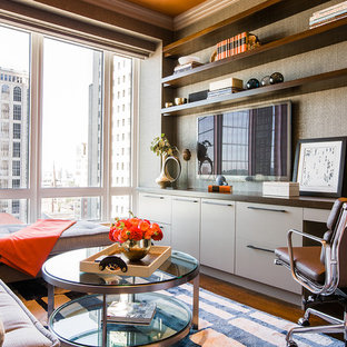 Example of a mid-sized trendy built-in desk medium tone wood floor study room design in Boston with brown walls