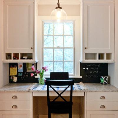 Elegant built-in desk home office photo in Newark
