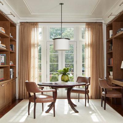 Transitional built-in desk dark wood floor and brown floor home office photo in Chicago
