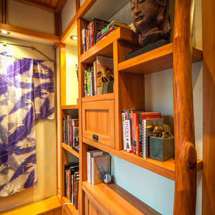 Example of a small zen built-in desk dark wood floor study room design in Chicago with green walls and no fireplace