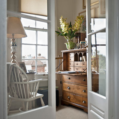 Inspiration for a timeless freestanding desk carpeted home office remodel in Cardiff with white walls