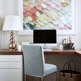 Design ideas for a transitional study room in Melbourne with beige walls, dark hardwood floors, a built-in desk and brown floor.