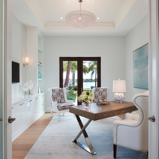 Example of a beach style freestanding desk light wood floor study room design in Miami with blue walls and no fireplace