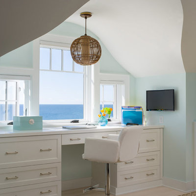 Inspiration for a coastal built-in desk light wood floor study room remodel in Bridgeport with green walls