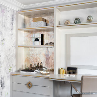 Inspiration for a large contemporary study in Surrey with carpet, a built-in desk, grey floors and white walls.