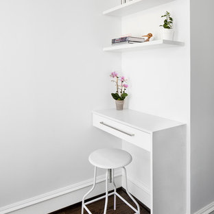 Study room - small modern built-in desk dark wood floor study room idea in DC Metro with white walls