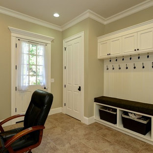 Home office - mid-sized traditional built-in desk linoleum floor home office idea in Seattle with beige walls