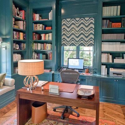 Small trendy built-in desk medium tone wood floor and brown floor study room photo in Dallas with blue walls and no fireplace