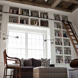 Home office library - huge cottage built-in desk dark wood floor and brown floor home office library idea in New York with white walls and no fireplace