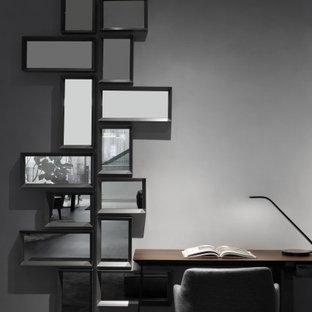Imagen de despacho ladrillo, actual, de tamaño medio, ladrillo, con paredes grises, suelo de madera oscura, escritorio independiente, suelo gris y ladrillo
