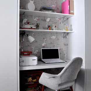 Inspiration for a small contemporary home office in London with a built-in desk.