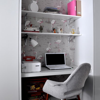 Example of a small trendy built-in desk home office design in London