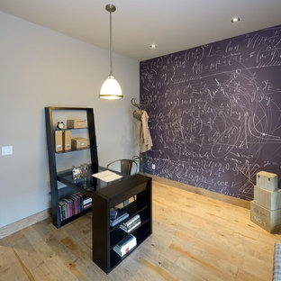 Example of a trendy home office design in Calgary with gray walls
