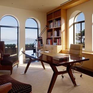 Example of a trendy home office design in San Francisco with white walls