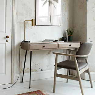 Example of a transitional white floor home office design in Other