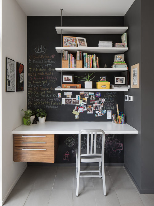 Example of a trendy built in desk gray floor study room design in ottawa with