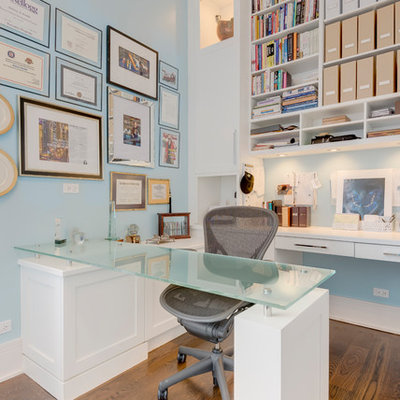 Example of a mid-sized trendy built-in desk medium tone wood floor and brown floor study room design in Chicago with blue walls