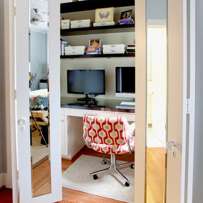 Example of a trendy built-in desk home office design in Dallas