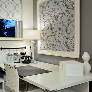 Example of a trendy freestanding desk home office design in Toronto with gray walls