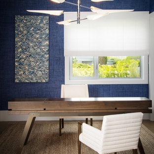 Example of a trendy freestanding desk study room design in New York with blue walls