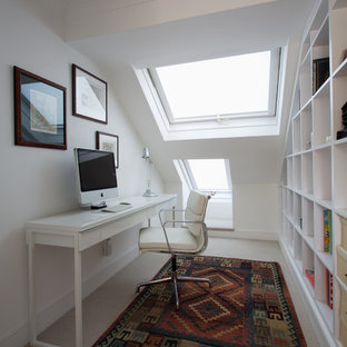 Study room - small contemporary freestanding desk carpeted study room idea in London with white walls and no fireplace