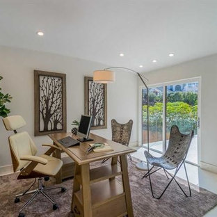 Example of a mid-sized zen freestanding desk concrete floor and white floor study room design in San Diego with white walls and no fireplace