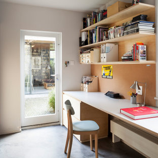 Photo of a small contemporary home studio in London with yellow walls, painted wood flooring, a wood burning stove, a metal fireplace surround, a built-in desk, grey floors, a wood ceiling and panelled walls.