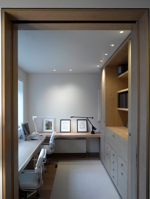 Inspiration For A Contemporary Dark Wood Floor Home Office Remodel In  London With White Walls