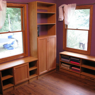 Design ideas for a small traditional craft room in Other with purple walls, light hardwood flooring and a built-in desk.