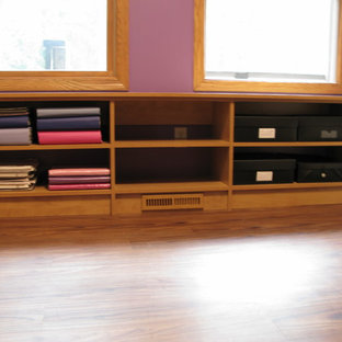 Small classic craft room in Other with purple walls, light hardwood flooring and a built-in desk.