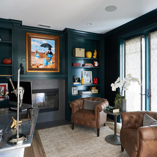 This is an example of a medium sized traditional home office and library in San Diego with a reading nook, green walls, light hardwood flooring, a standard fireplace, a tiled fireplace surround and a freestanding desk.