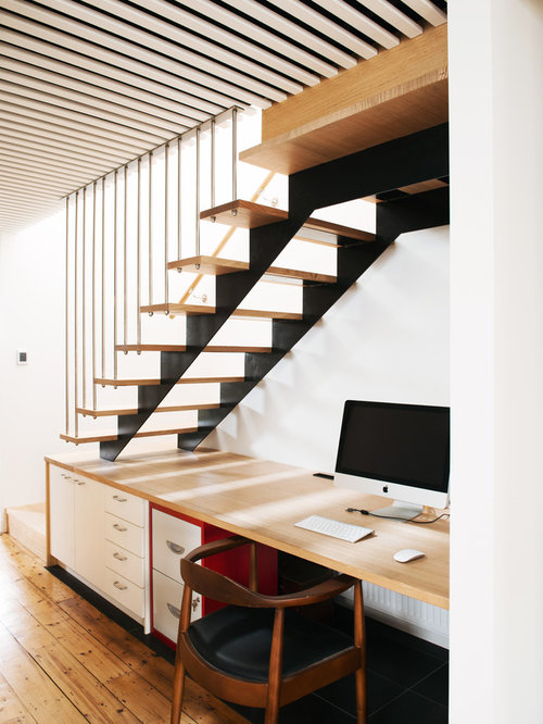 Inspiration for a mid-sized scandinavian built-in desk medium tone wood  floor study