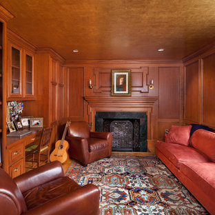 Inspiration for a timeless built-in desk medium tone wood floor home office remodel in DC Metro with a stone fireplace