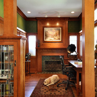 Inspiration for an arts and crafts home office in Dallas with green walls, a tile fireplace surround and a standard fireplace.