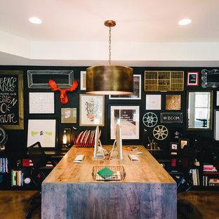 Home studio - large industrial built-in desk concrete floor home studio idea in Atlanta with black walls