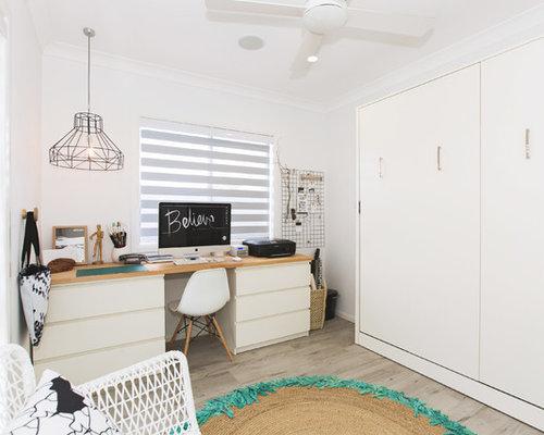 Home studio scandinavian freestanding desk vinyl floor home studio idea in sydney with white walls