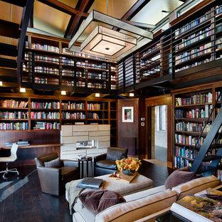 他の地域の巨大なコンテンポラリースタイルのおしゃれなホームオフィス・書斎 (濃色無垢フローリング、造り付け机、黒い床、ライブラリー、茶色い壁、横長型暖炉、タイルの暖炉まわり) の写真