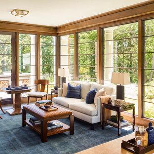 ボストンの広いトラディショナルスタイルのおしゃれな書斎 (茶色い壁、濃色無垢フローリング、コーナー設置型暖炉、金属の暖炉まわり、自立型机、茶色い床) の写真