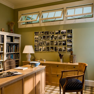 Home office - traditional freestanding desk carpeted home office idea in New York with green walls